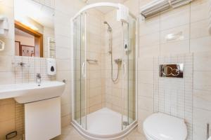Kúpeľňa v ubytovaní Domus Mater Hotel