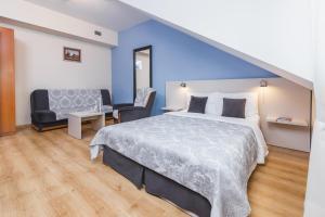 Posteľ alebo postele v izbe v ubytovaní Domus Mater Hotel