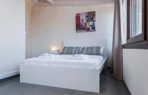 A bed or beds in a room at Old Tannery House