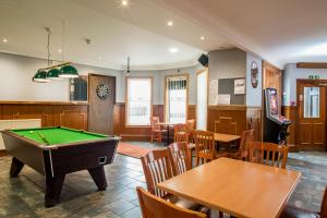 A pool table at Station Hotel