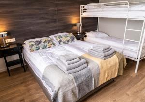 Кровать или кровати в номере Black Beach Guesthouse
