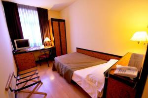 Un ou plusieurs lits dans un hébergement de l'établissement Hotel Glòries