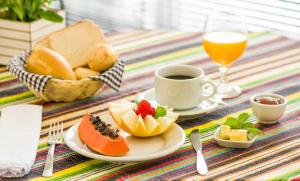 Breakfast options available to guests at Novo Hamburgo Business Hotel