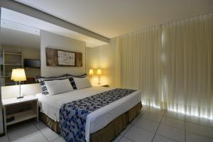 A bed or beds in a room at Littoral Express