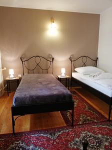 Posteľ alebo postele v izbe v ubytovaní V Penzión