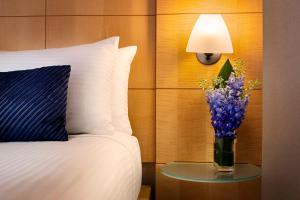 A bed or beds in a room at Millennium Premier New York Times Square