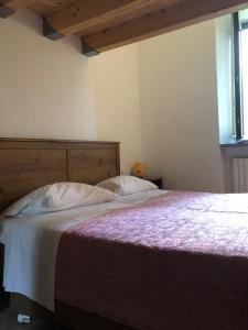 Кровать или кровати в номере Albergo Ristorante Monte Piella