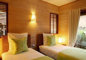 Cama ou camas em um quarto em MOOREA - Villa Fetia