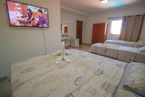 A bed or beds in a room at Pousada Bonito Cama e Café