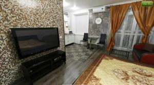 Телевизор и/или развлекательный центр в Апартаменты Amazing Studio