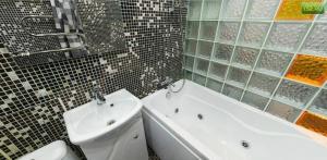 Ванная комната в Апартаменты Amazing Studio