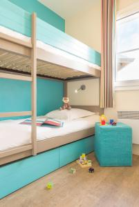 A bunk bed or bunk beds in a room at Residence Pierre & Vacances Port Guillaume