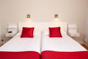 Säng eller sängar i ett rum på Hotel Emma