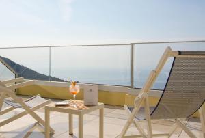 A balcony or terrace at Les Terrasses d'Eze - Hôtel & Spa