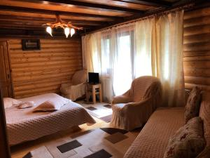 A bed or beds in a room at Cabana Bradul