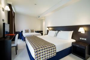 Säng eller sängar i ett rum på Exe Málaga Museos