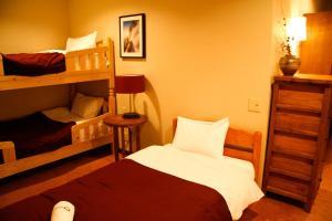 A bunk bed or bunk beds in a room at Morino Lodge - Hakuba