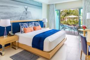 A bed or beds in a room at Harbor Club St Lucia, Curio Collection by Hilton