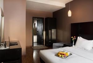 A bed or beds in a room at Areos