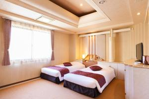 A bed or beds in a room at Hotel In Kyoto Sasarindou