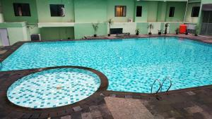 The swimming pool at or near Strategic 2BR Menteng Square Apartment By Travelio