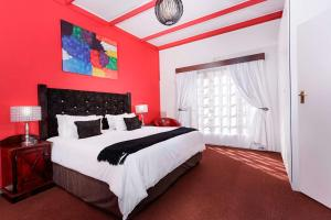 A bed or beds in a room at Best Western Cape Suites Hotel