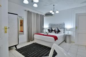 A bed or beds in a room at Villa Simonne