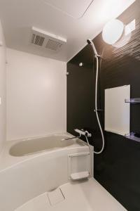 A bathroom at AOCA Kaminoge 501
