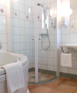 Ett badrum på Best Western Strand Hotel