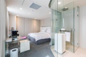 A bed or beds in a room at The Grove Design Hotel