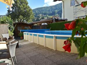 The swimming pool at or near B&B Appartements Glungezer