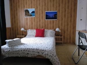 Llit o llits en una habitació de Hostal Juventus