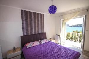 Łóżko lub łóżka w pokoju w obiekcie Rooms Villa Marija