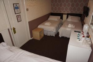 A bed or beds in a room at The Butlers Hotel