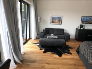 Ein Sitzbereich in der Unterkunft Voss Villa