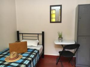 A bed or beds in a room at Andaina Youth Hostel
