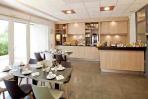 Restaurant ou autre lieu de restauration dans l'établissement Séjours & Affaires Grenoble Marie Curie