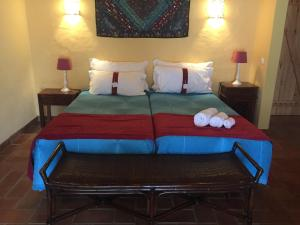 A bed or beds in a room at Casa Vicentina