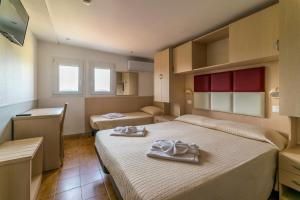 Ein Bett oder Betten in einem Zimmer der Unterkunft Hotel Stresa