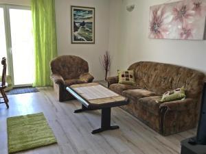 Area soggiorno di Apartments Vuleta