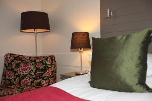 Säng eller sängar i ett rum på Best Western Plus Edward Hotel