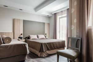 A bed or beds in a room at Hotel Civera