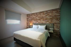 A bed or beds in a room at Hotel 88 Bekasi