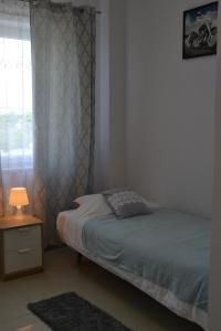 A bed or beds in a room at Hostel P&K Wolka Kosowska
