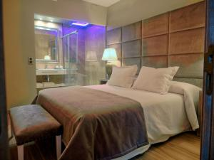 A bed or beds in a room at Hostal San Andres