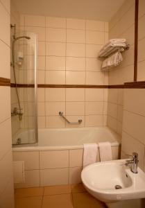 A bathroom at Ararat All Suites Hotel Klaipeda