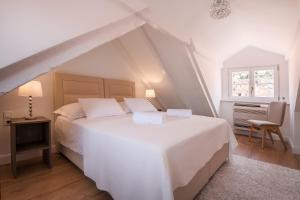A bed or beds in a room at The St Blaise Swanky Collection