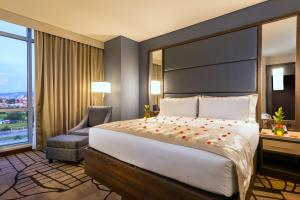 A bed or beds in a room at Hilton Garden Inn Bogota Airport