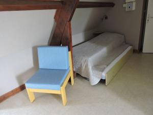 A bed or beds in a room at Les Berges