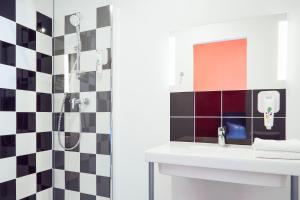 A bathroom at ibis Styles Marseille Vieux Port